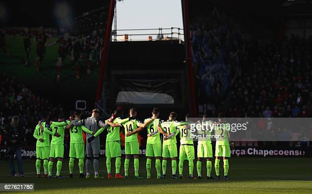 Liverpool players observe a minutes silence for the victims of the plane crash involving the Brazilian club Chapecoense prior to the Premier League...