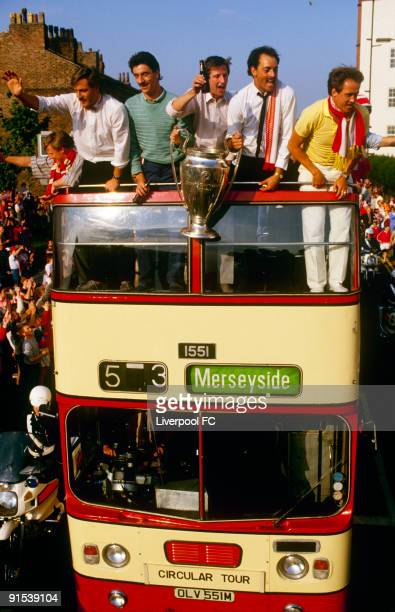 Liverpool players parade the European cup trophy from on top of an open bus for a victory parade through the city David Hodgson Ian Rush Ronnie...