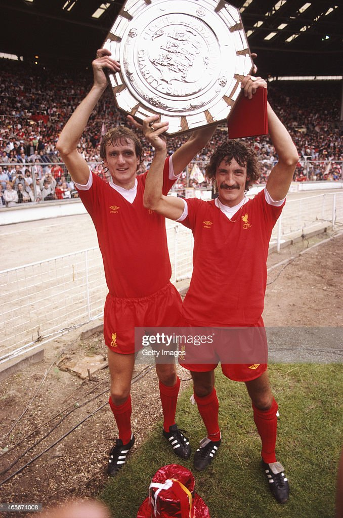 Liverpool players Phil Thompson (l) and Terry McDermott hold the FA Charity Shield aloft after a 1-0 win over West Ham at Wembley Stadium on August 9, 1980 in London, England.