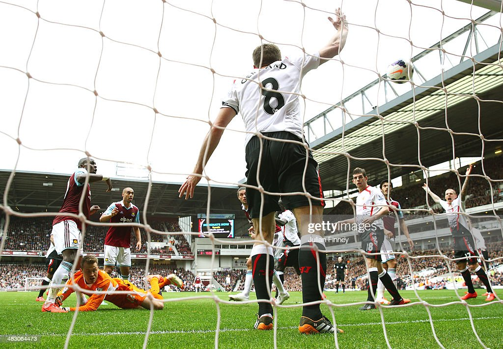 Liverpool players protest as Guy Demel (L) of West Ham scores past goalkeeper Simon Mignolet of Liverpool to level the scores at 1-1 during the Barclays Premier League match between West Ham United and Liverpool at Boleyn Ground on April 6, 2014 in London, England.