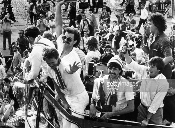 Liverpool players proudly show off the European Cup trophy to thousands of fans who lined the streets of Liverpool to welcome their heroes home...