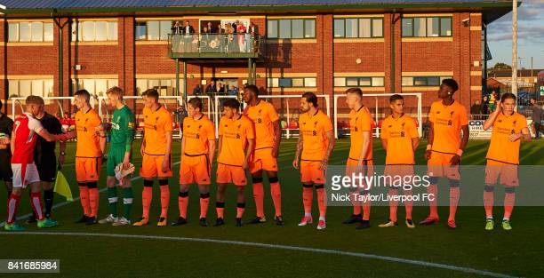 Liverpool players ready to shake hands with the Fleetwood Town players before the Molson Coors Senior Cup Final at The County Ground on September 1...
