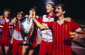 Liverpool players Steve Nicol Kenny Dalglish Alan Hansen Gary Gillespie and captain Greaeme Souness celebrate with the trophy after winning the UEFA...