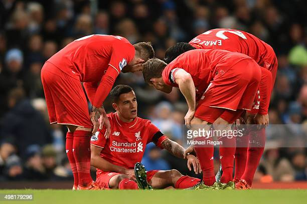 Liverpool players talks to Philippe Coutinho during the Barclays Premier League match between Manchester City and Liverpool at Etihad Stadium on...