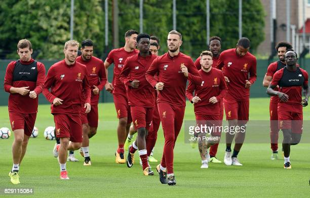 Liverpool players warm up during a training session at Melwood Training Ground on August 10 2017 in Liverpool England