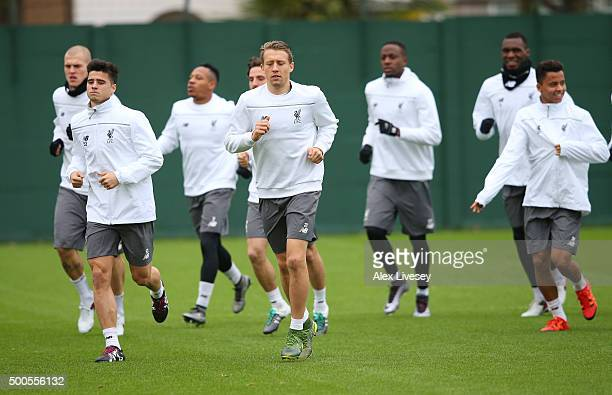 Liverpool players warm up during the Liverpool training session at the Melwood training ground on December 9 2015 in Liverpool England