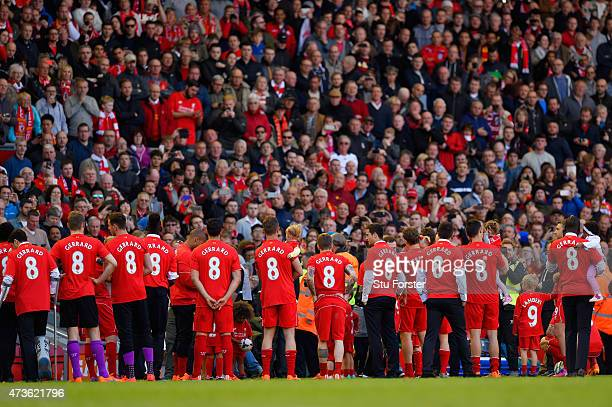 Liverpool players wear Steven Gerrard of Liverpool replica shirts as they wait to pay tribute to Steven Gerrard on his final game at Anfield during...