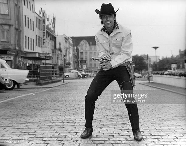 Liverpool singer Lee Curtis poses for a portrait on the Reeperbahn circa 1964 in Hamburg Germany