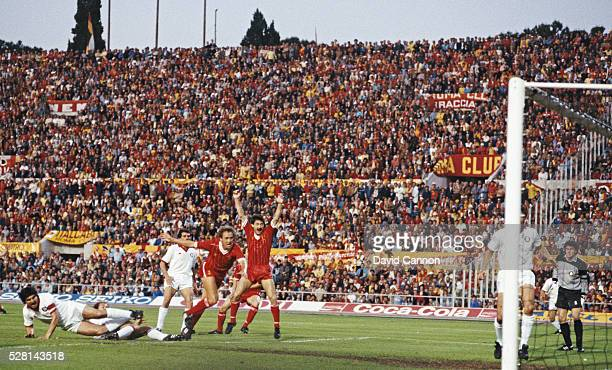 Liverpool striker Ian Rush celebrates as full back Phil Neal scores the Liverpool goal during the 1984 European Cup Final between AS Roma and...