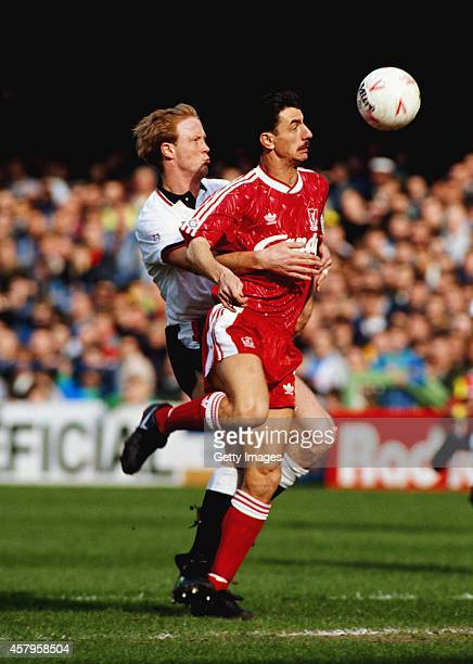 Liverpool striker Ian Rush is challenged by Derby defender Mark Wright during a League Division One match between Derby County and Liverpool at the...