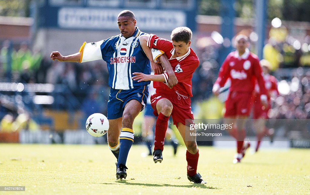 Liverpool striker Michael Owen challenges Sheffield Wednesday defender Des Walker during an FA Carling Premiership match between Sheffield Wednesday...