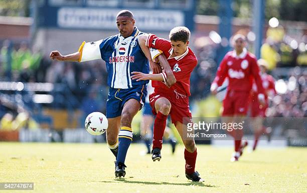 Liverpool striker Michael Owen challenges Sheffield Wednesday defender Des Walker during an FA Carling Premiership match between Sheffield Wednesday...