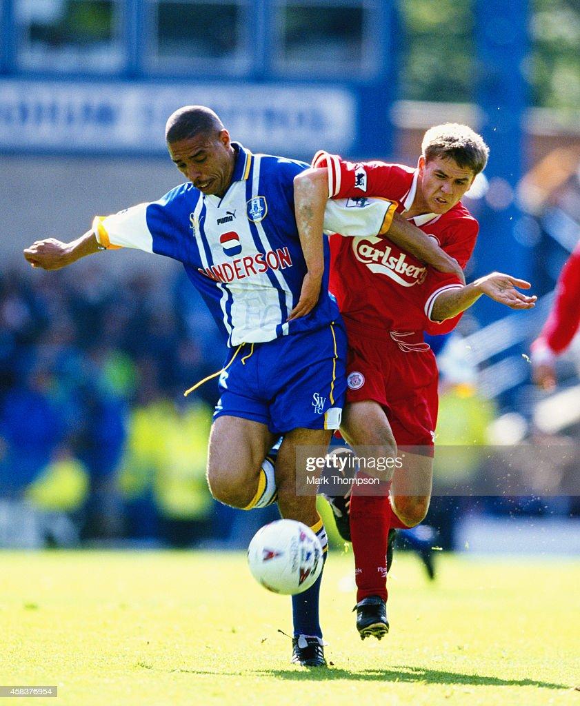 Liverpool striker Michael Owen challenges Sheffield Wwednesday defender Des Walker during an FA Carling Premiership match between Sheffield Wednesday...