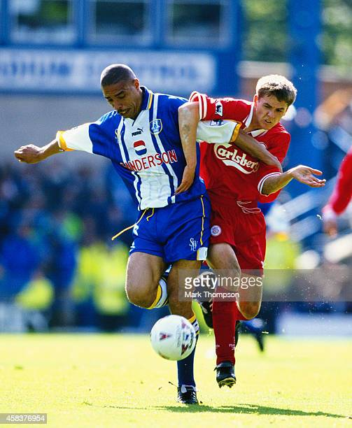 Liverpool striker Michael Owen challenges Sheffield Wwednesday defender Des Walker during an FA Carling Premiership match between Sheffield Wednesday...