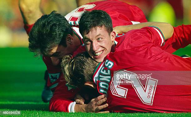 Liverpool striker Robbie Fowler celebrates with Ian Rush and Rob Jones after scoring the second goal in an FA Premier League match between Liverpool...