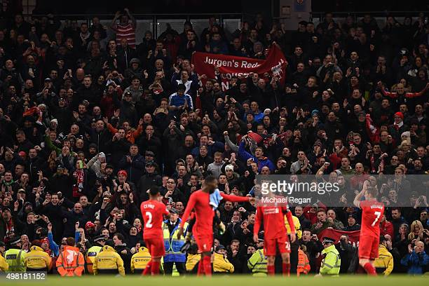 Liverpool supporters celebrate their team's 41 win in the Barclays Premier League match between Manchester City and Liverpool at Etihad Stadium on...
