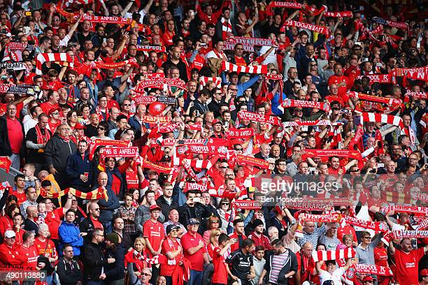 Liverpool supporters cheer prior to the Barclays Premier League match between Liverpool and Aston Villa at Anfield on September 26 2015 in Liverpool...