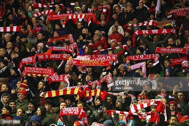 Liverpool supporters soak up the atmosphere prior to the Barclays Premier League match between Liverpool and Arsenal at Anfield on January 13 2016 in...