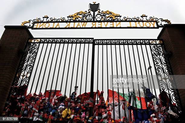Liverpool supporters tie scarves to the Shankly Gates before a memorial service to mark the twentieth anniversary of the Hillsborough disaster at...