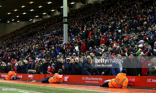 Liverpool supporters walk out to protest against the ticket price hike at the 77th minutes during the Barclays Premier League match between Liverpool...