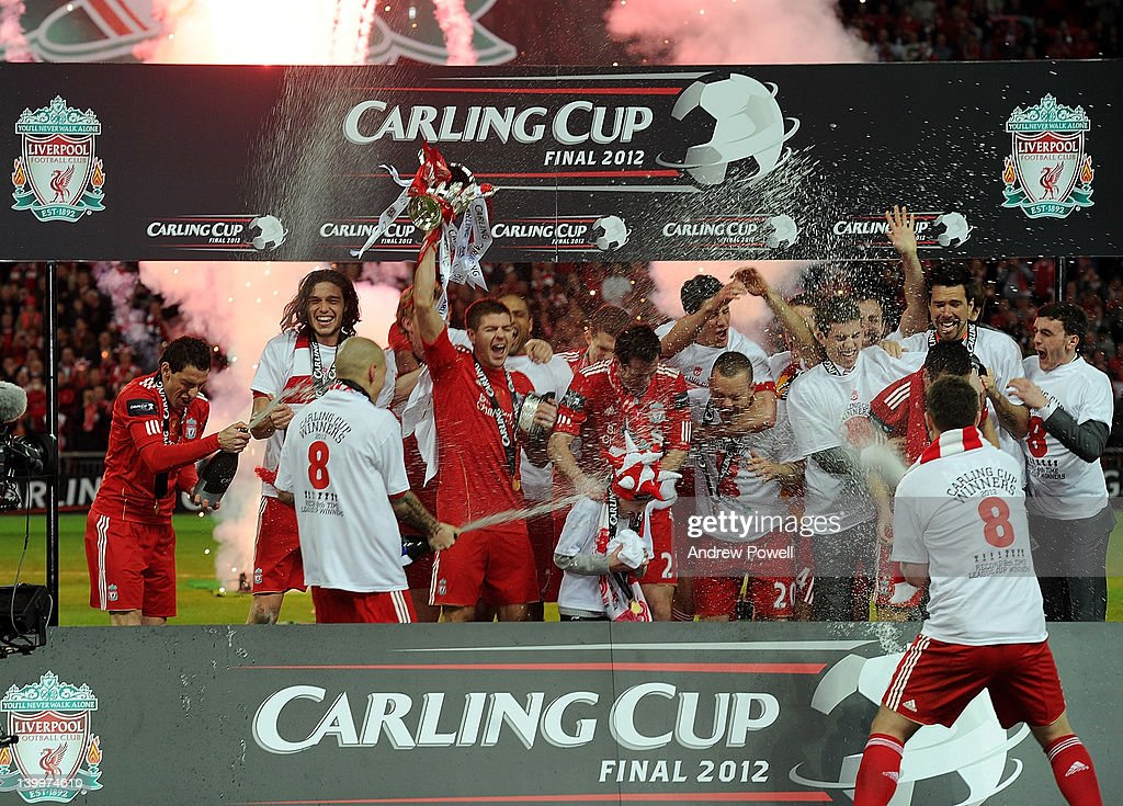 Liverpool team celebrate their win with the trophy at the end of the Carling Cup Final match between Liverpool and Cardiff City at Wembley Stadium on February 26, 2012 in London, England.