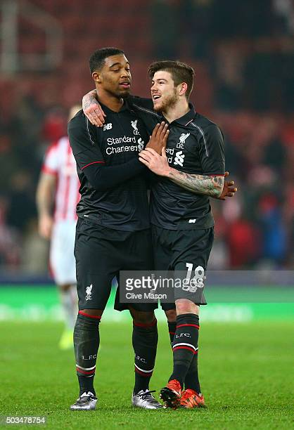 Liverpool teammates Jordon Ibe and Alberto Moreno celebrate their team's 10 victory during the Capital One Cup semi final first leg match between...