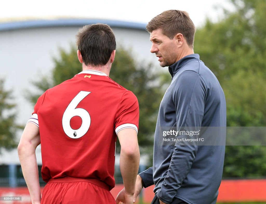 Liverpool U18 Manager Steven Gerrard talks to his captain Liam Coyle (6) during the Liverpool v Blackburn Rovers U18 Premier League game at The Kirkby Academy on August 19, 2017 in Liverpool, England.
