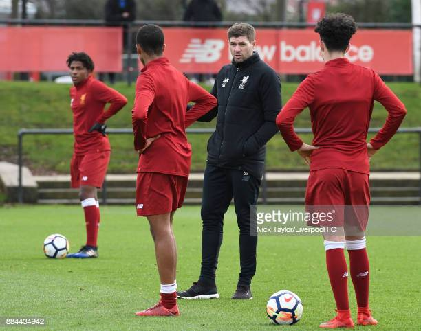 Liverpool U18 manager Steven Gerrard talks to his players during the warmup before the Liverpool v Sunderland U18 Premier League Cup game at The...
