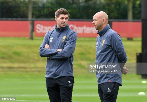 Liverpool U18 manager Steven Gerrard talks with Rob Jones before the Liverpool v Blackburn Rovers U18 Premier League game at The Kirkby Academy on...