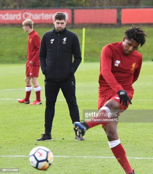 Liverpool U18 manager Steven Gerrard watches his player Yasser Larouci during the warmup before the Liverpool v Sunderland U18 Premier League Cup...