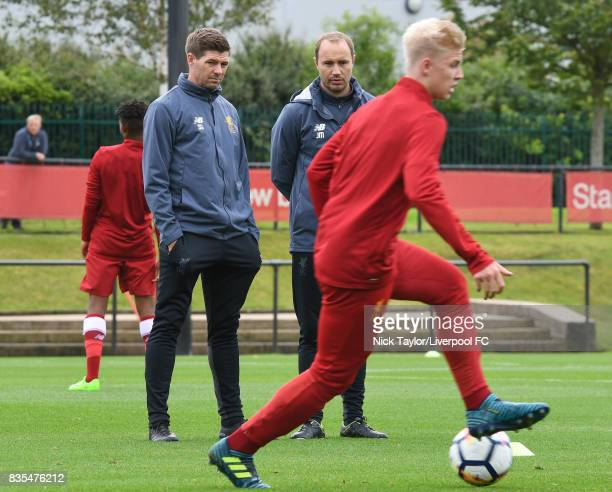 Liverpool U18 manager Steven Gerrard watches his players during the warmup before the Liverpool v Blackburn Rovers U18 Premier League game at The...