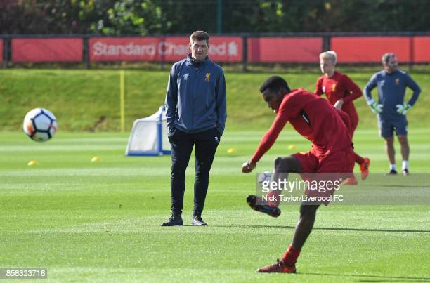 Liverpool U18 manager Steven Gerrard watches his players warm up before the U18 friendly match between Liverpool and Burnley at The Kirkby Academy on...