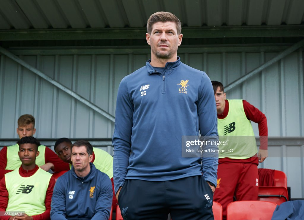 Liverpool U18 manger Steven Gerrard (centre) takes his place in the home dugout for his first home game in charge before the Liverpool v Blackburn Rovers U18 Premier League game at The Kirkby Academy on August 19, 2017 in Liverpool, England.