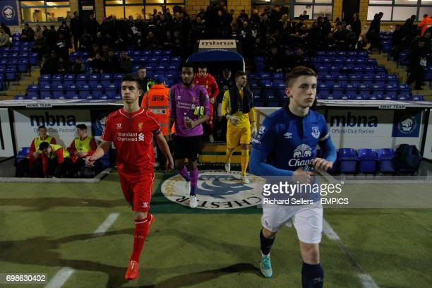 Liverpool U21's Cameron Brannagan and Everton U21's JohnJoe Kenny lead out the teams