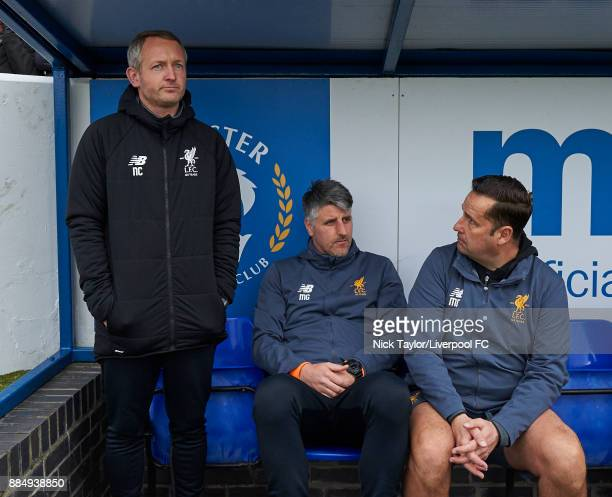 Liverpool U23 manager Neil Critchley with coach Mike Garrity and goalkeeping coach Mark Morris during the Liverpool v Stoke City Premier League Cup...