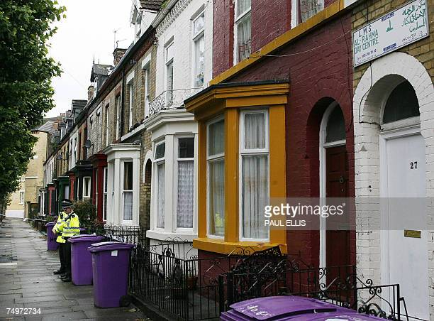 British police officers stand outside a house in the Toxteth area of Liverpool north west England 01 July 2007 Police have confirmed a further...