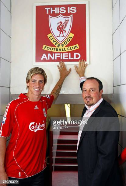 Liverpool football Club's new signing Fernando Torres poses for photographs with manager Rafael Benitez before a press conference at Anfield...