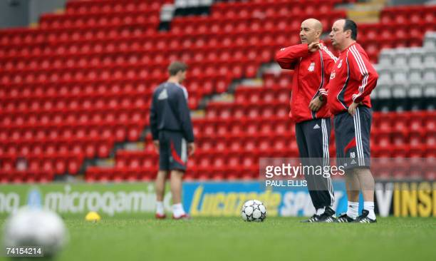 Liverpool manager Rafael Benitez and assistant manager Pako Ayestaran watch during a training session at Anfield Liverpool north west England 15 May...