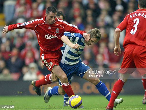 Liverpool's Jamie Carragher pushes past Reading's Kevin Doyle during their English Premiership footall match at Anfield Liverpool England 04 November...