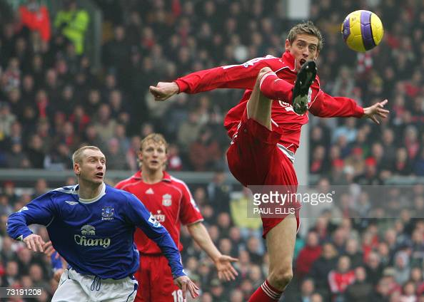 Liverpool's Peter Crouch rises for the ball against Everton during their English Premeirship football match at Anfield Liverpool northwest England 03...