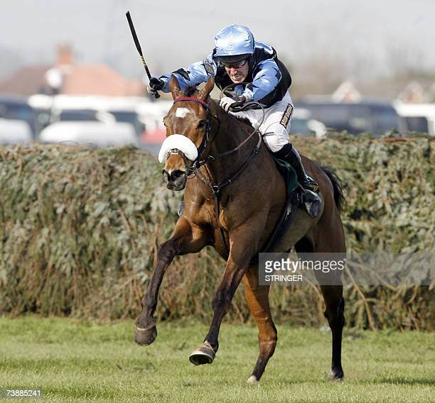 Winner Silver Birch ridden by Bobby Power clears the last fence during the Grand National Steplechase at the Aintree Racecourse Liverpool northwest...