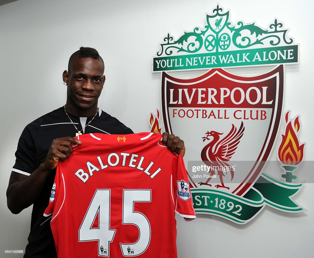 (MINIMUM FEES APPLY - 150 GBP PRINT & 75 GBP ONLINE OR LOCAL EQUIVALENT, PER IMAGE). Liverpool unveil their new signing <a gi-track='captionPersonalityLinkClicked' href=/galleries/search?phrase=Mario+Balotelli&family=editorial&specificpeople=4940446 ng-click='$event.stopPropagation()'>Mario Balotelli</a> at Melwood on August 25, 2014 in Liverpool, England.