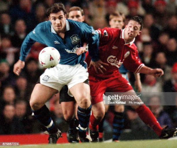Liverpool V Everton Hold it right there Liverpool's Robbie Fowler keeps tabs on Everton's David Unsworth during the Premiership derby at Anfield this...