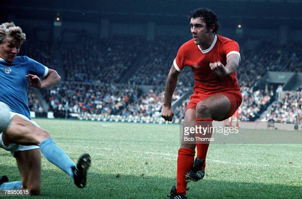 Liverpool v Manchester City Liverpool's Ray Kennedy fires in a shot under pressure from a Manchester City defender