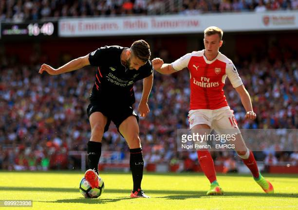 Liverpool's Adam Lallana and Arsenal's Rob Holding battle for the ball