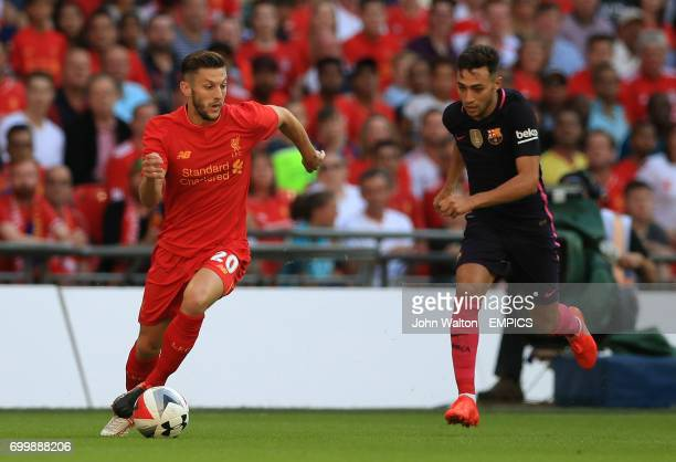 Liverpool's Adam Lallana and Barcelona's Munir El Haddadi battle for the ball