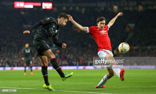 Liverpool's Adam Lallana and Manchester United's Matteo Darmian battle for the ball