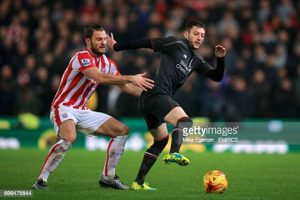 Liverpool's Adam Lallana and Stoke City's Erik Pieters battle for the ball