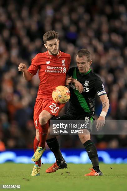 Liverpool's Adam Lallana and Stoke City's Glenn Whelan battle for the ball