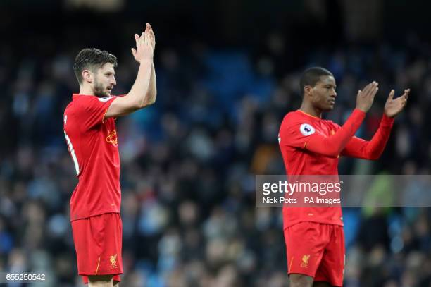 Liverpool's Adam Lallana applauds the fans after the Premier League match at the Etihad Stadium Manchester